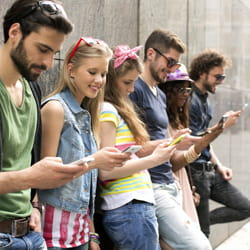 Teenagers on their smartphones to represent marketing strategy plan